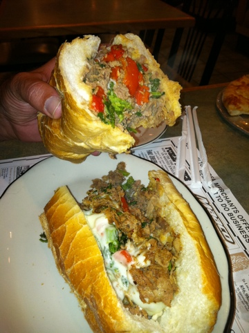 Foot-long cheesesteak Italiano: steak, provolone, broccoli raab, roasted peppers and onions. Take the canoli. Leave the sandwich!