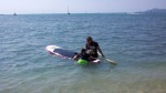 Giving Kid1 a briefing on stand-up paddle boarding.