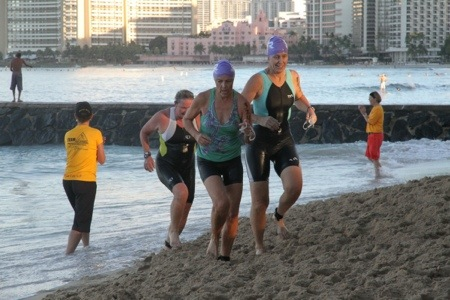Emerging from the ocean. I'm third here, getting cheered by my Try Fitness teammate.