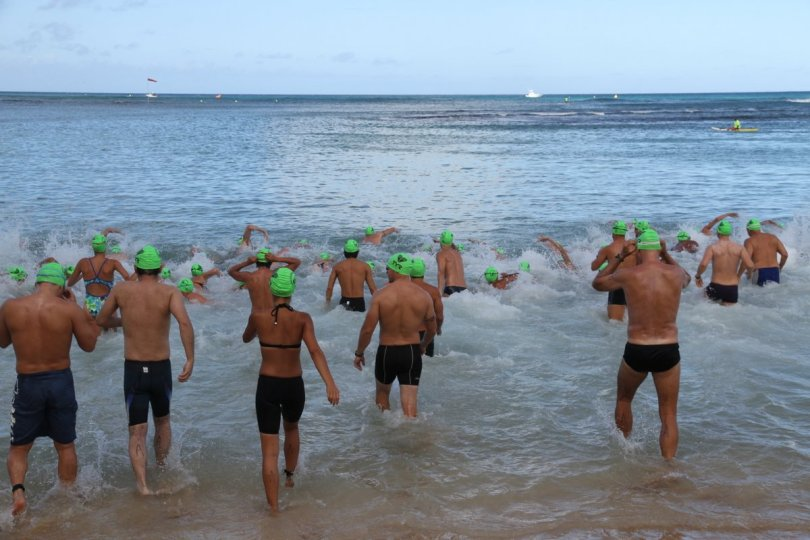 Waikiki Roughwater Swim wave A launches. The fasties. The elites. John Bender photo.