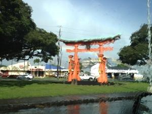 The replicat Torii Gate at Moiliili through my van's window in the rain.