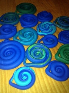 Kid2 is creating an inventory of Fimo swirls for jewelry. One of the many endeavors she launches into.