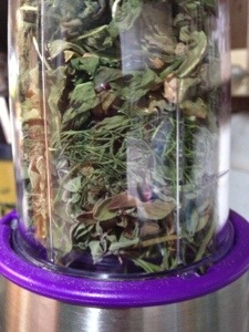 Herbs dried and stacked in the chopper.