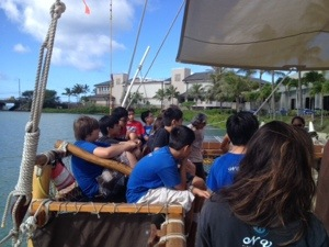 Students learn about the Hokule'a.