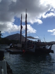 Hokule'a docked in Koko Marina. Koko Crater in the distance.