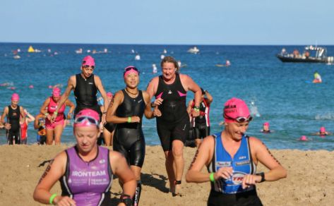 Swim to bike transition. See how happy everyone is around me? I just realized my time was slower than last year.