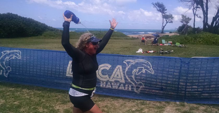 Elated at my finish, pouring water over my head.