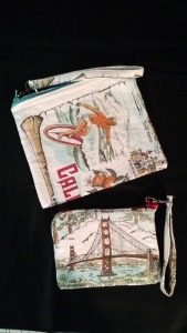 A California tea towel turned into two zip purses with matching straps.
